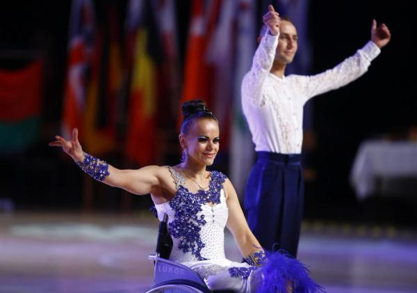 Hanna Stasiuk and Ihar Kuliashou of Belarus celebrate as they win gold in Combi Lat 1 competition during IPC Wheelchair Dance Sport European Championships in Lomianki near Warsaw