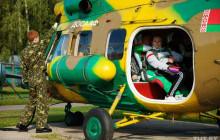 Видеофакт. Шестеро колясочников прыгнули с парашютами на Боровой