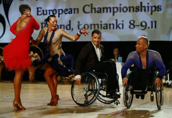 Pawel Karpinski and Nadine Kinczel of Poland dance near Maksim Sedakov and Svetlana Kukushkina of Russia during IPC Wheelchair Dance Sport European Championships in Lomianki near Warsaw